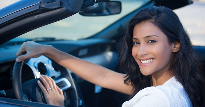 young lady behind the wheel of her car